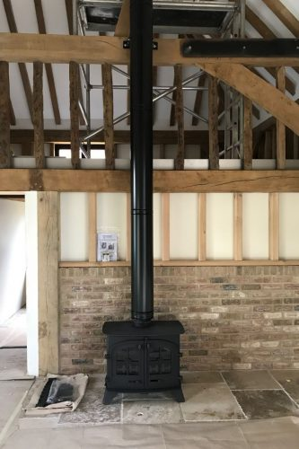wood burning stove in barn conversion Sussex stove and maintenance