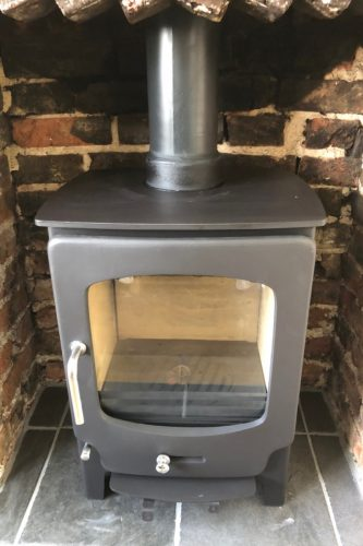 Wood burning stove brick opening Sussex stove and maintenance